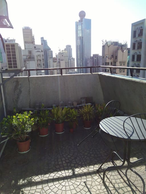 Sunny roof terrace with table and chairs