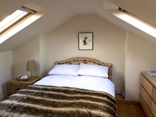 Cosy attic room in family home