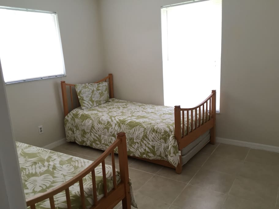 One of the 3 bedrooms- with two single beds and full wall to wall closet.