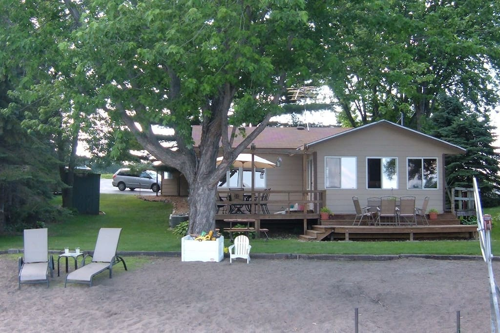 Enjoy your own private sandy beach! Swim, fish, take the canoe or paddle boat out!
