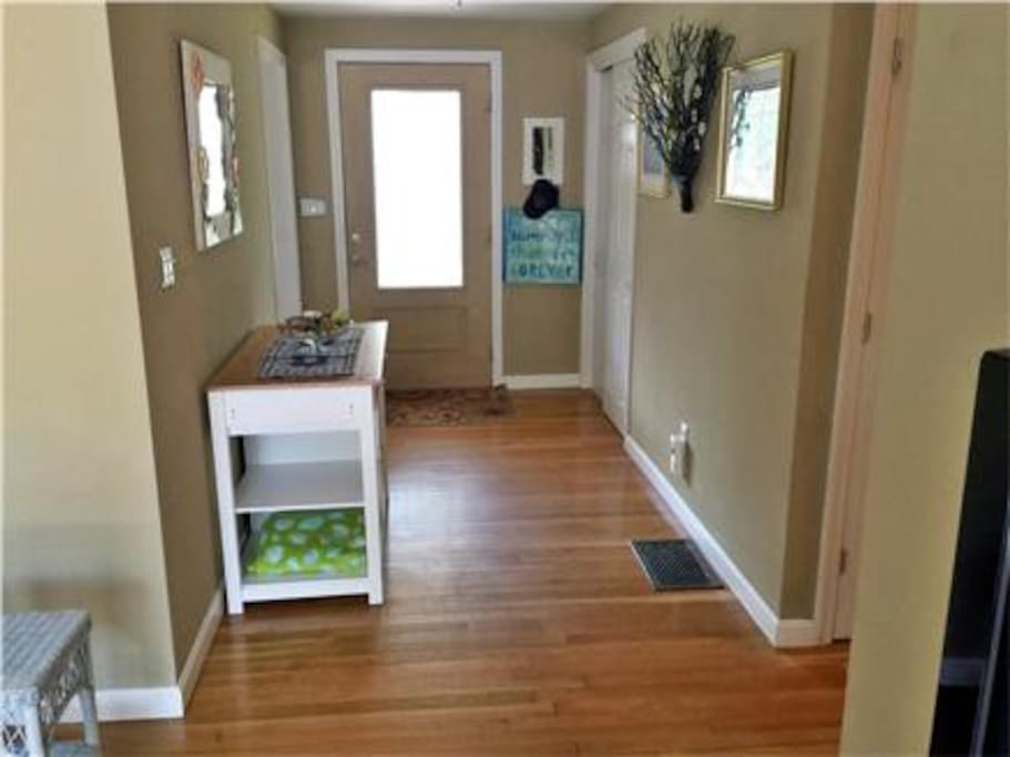 Entryway. Home features hardwood throughout.