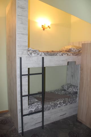 Single bed in a Family Room with Shared Bathroom