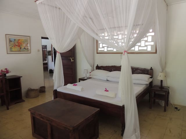 Moja Bedroom with king size bed, fan and mosquito nets