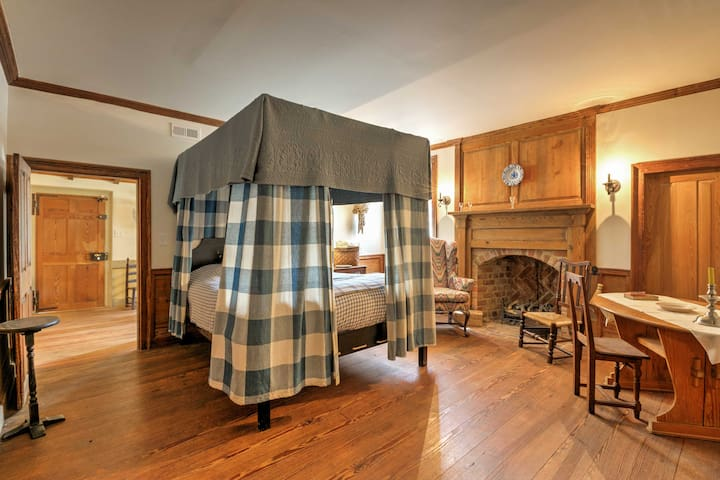 This beautiful bedroom has a full bed with a protective canopy.