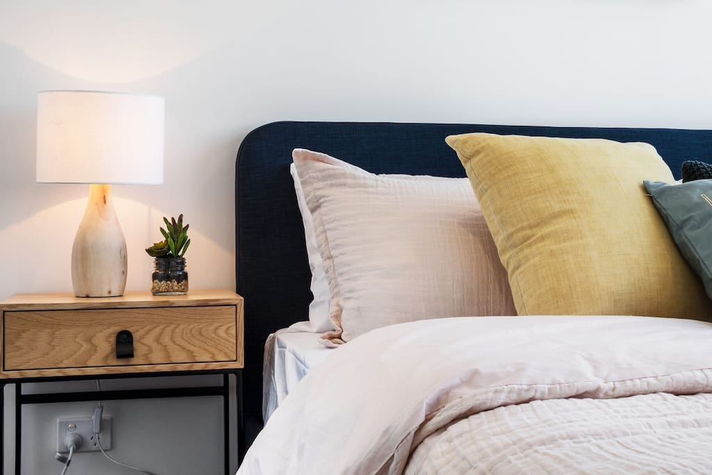 A cosy queen size bed lined with hotel quality linen - cleaned and prepared before you arrive.