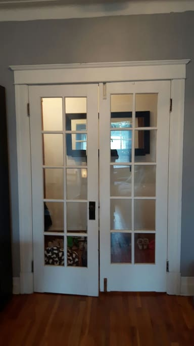French doors can be closed for another sleeping space