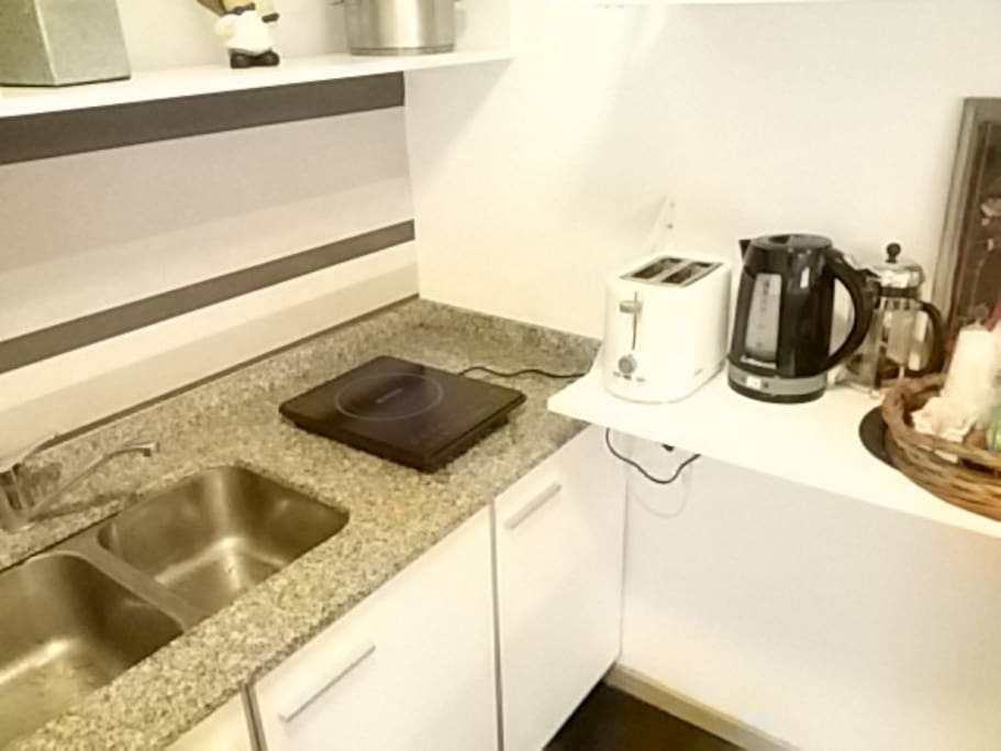 Kitchen equipment: electric stove , microwave oven, electric water heater and toaster.