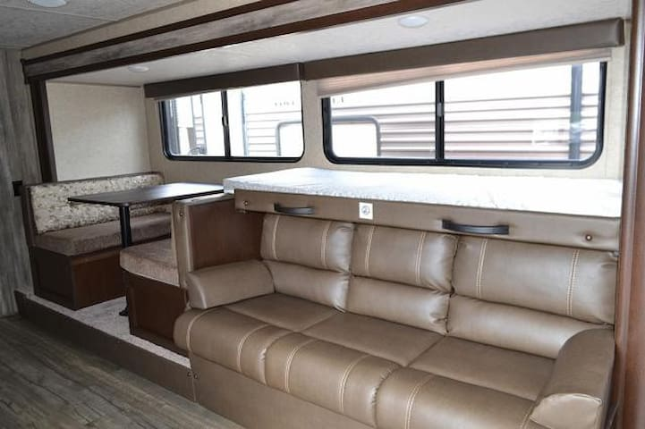 This unit includes a slide out for spacious sitting area