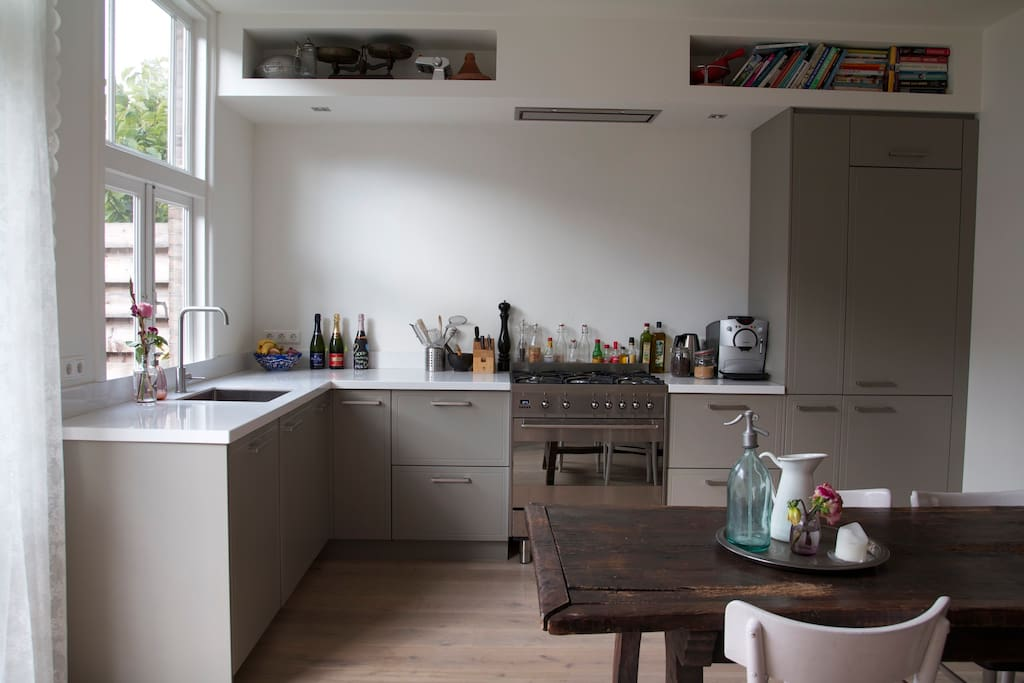 Kitchen fully equipped with 5-pit stove, oven, fridge, dishwasher