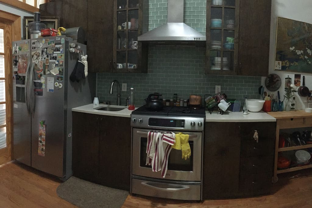 Full recently renovated kitchen, large fridge, dining table (not pictured)
