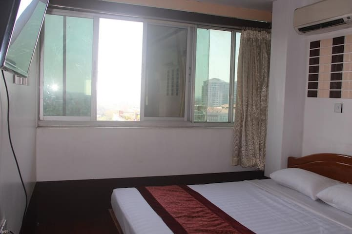 Double bed at MGM Hotel Yangon Myanmar