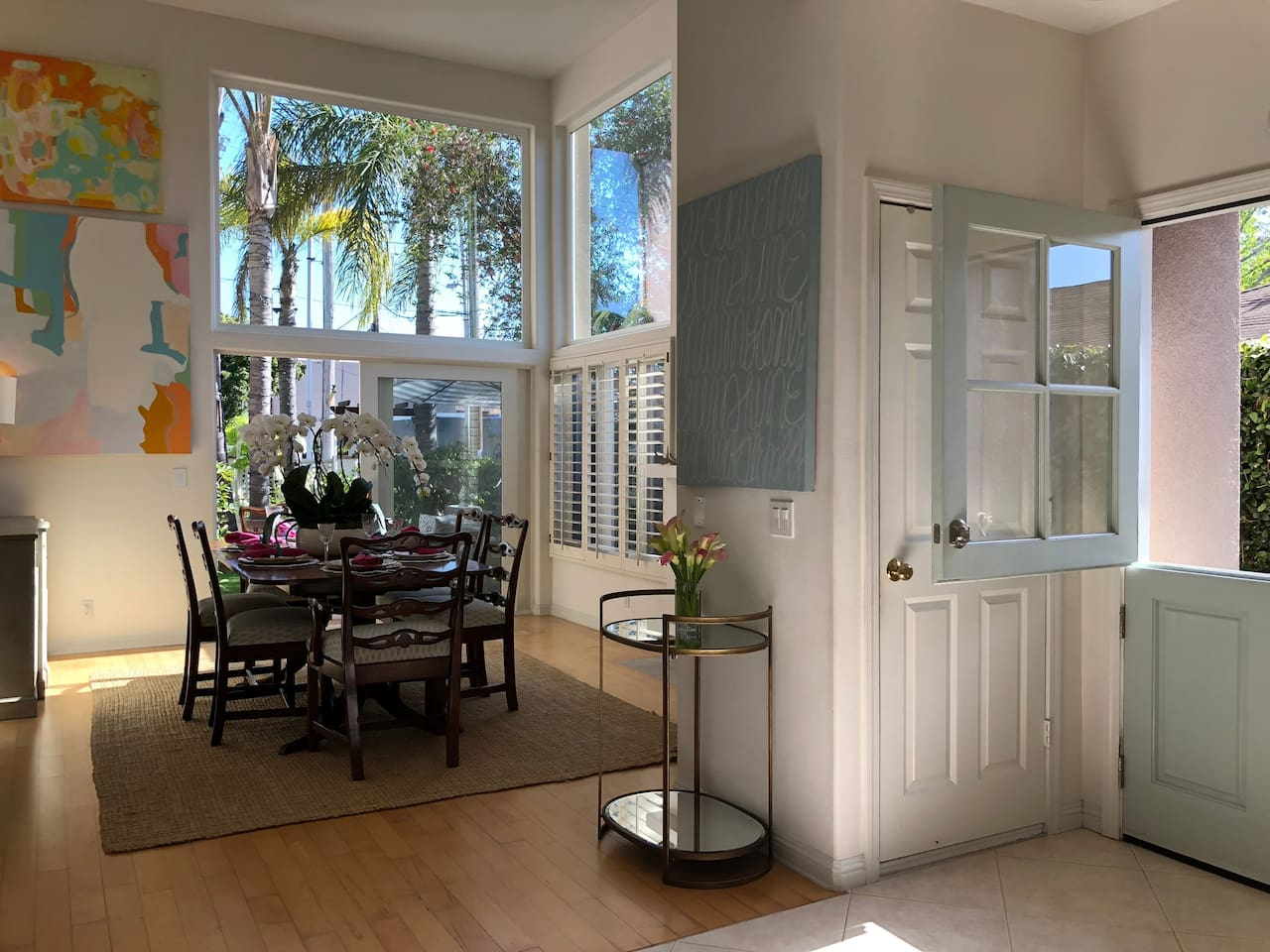Nothing says welcome like a light turquoise Dutch door