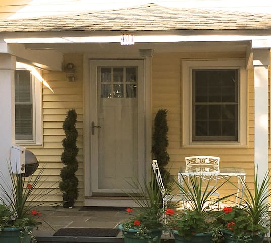 Beautiful 1 bedroom cottage yards from the beach