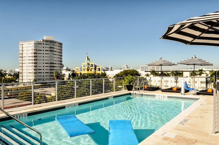 Stylish Room with Queen Bed, One Minute from the Beach, Two Gorgeous Pools and Rooftop Sundeck