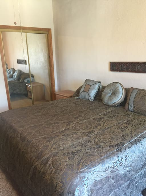 King size bed with closet and chest of drawers