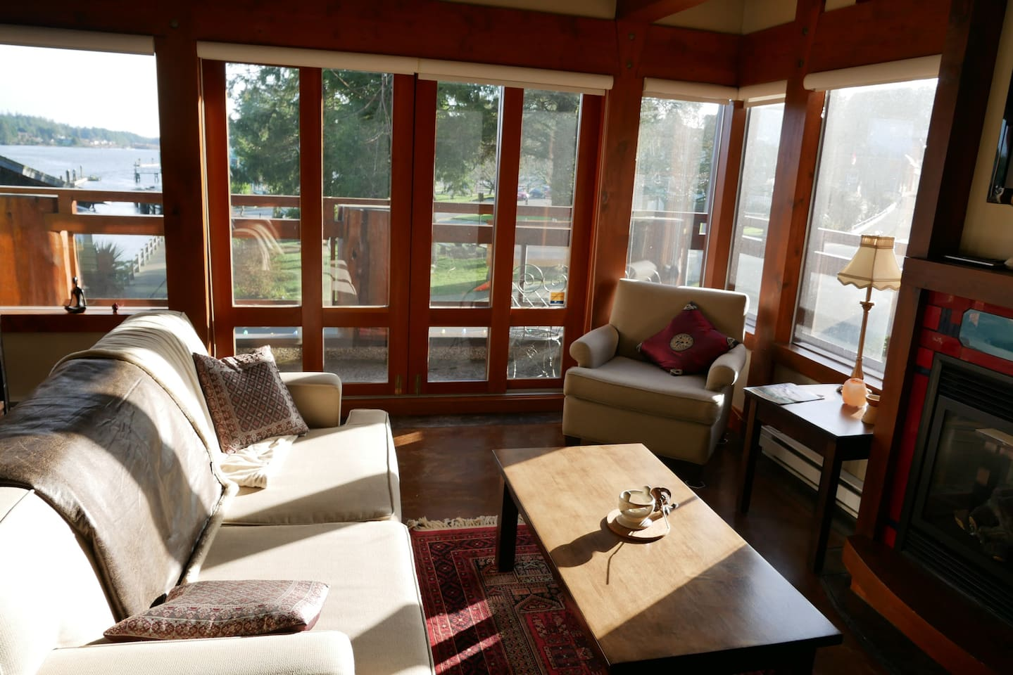 Living room with view of the water and wrap around deck