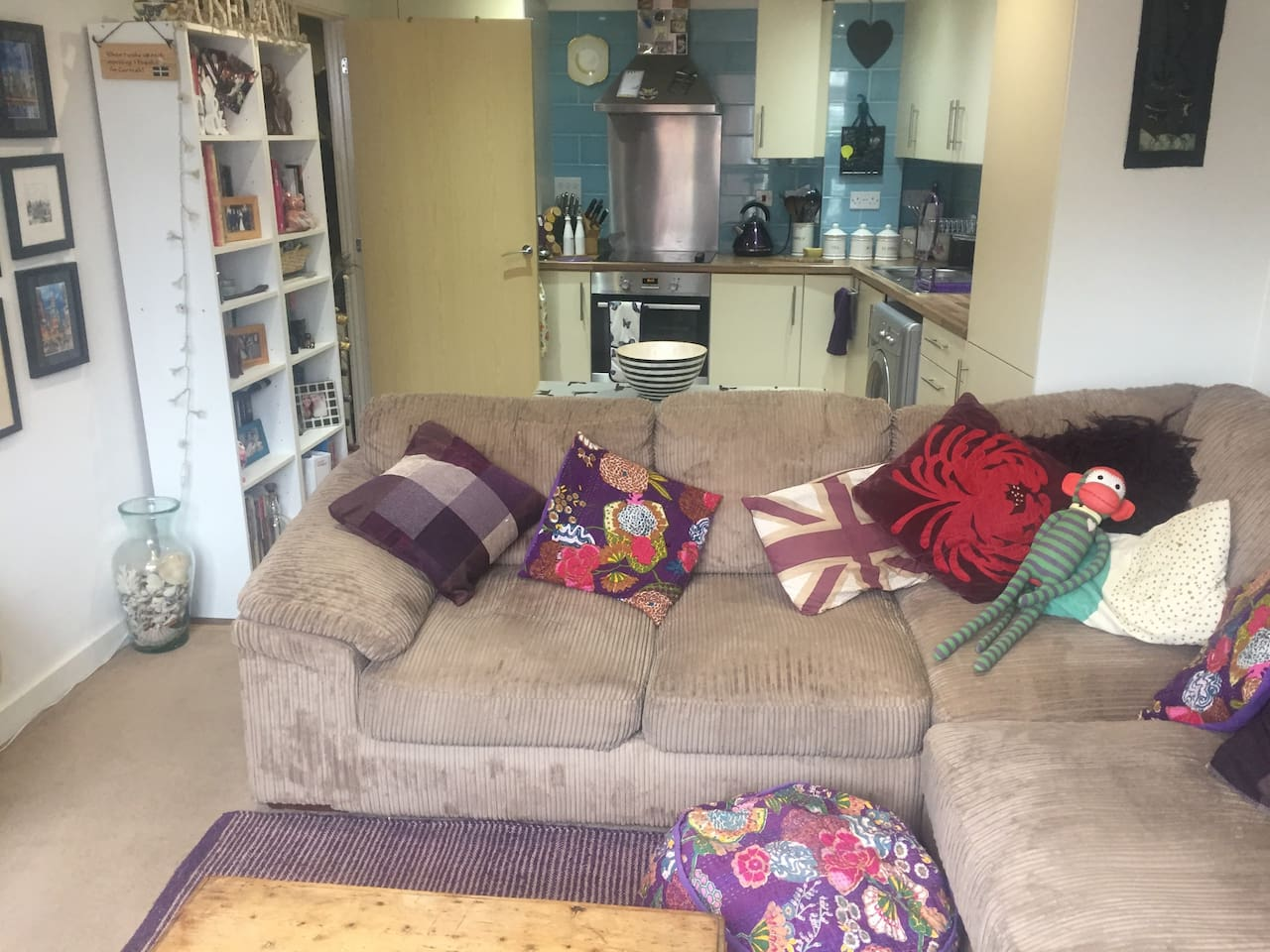 Open plan kitchen and living room with sofa bed