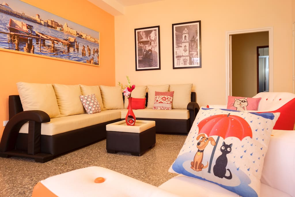 Large living room with modern and comfortable furniture decorated with original photos by the owners. The apartment has been fully refurbished and all furniture and appliances are new.