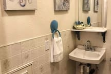 Sea life greats you in the bathroom that is separate from the shower and studio.