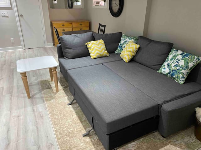 The sofa pulls out to a double bed sleeps two comfortably. The cushion lifts up to reveal fresh linens and a memory-foam mattress pad with a cover that is washed between guests.  (Note: A portable pack 'n' play crib is also available if needed.)