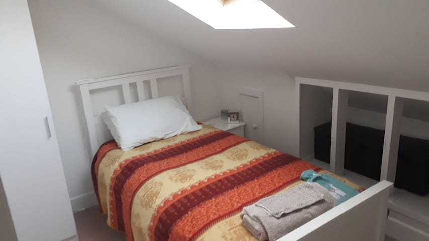 Single bed with wardrobe and bedside table