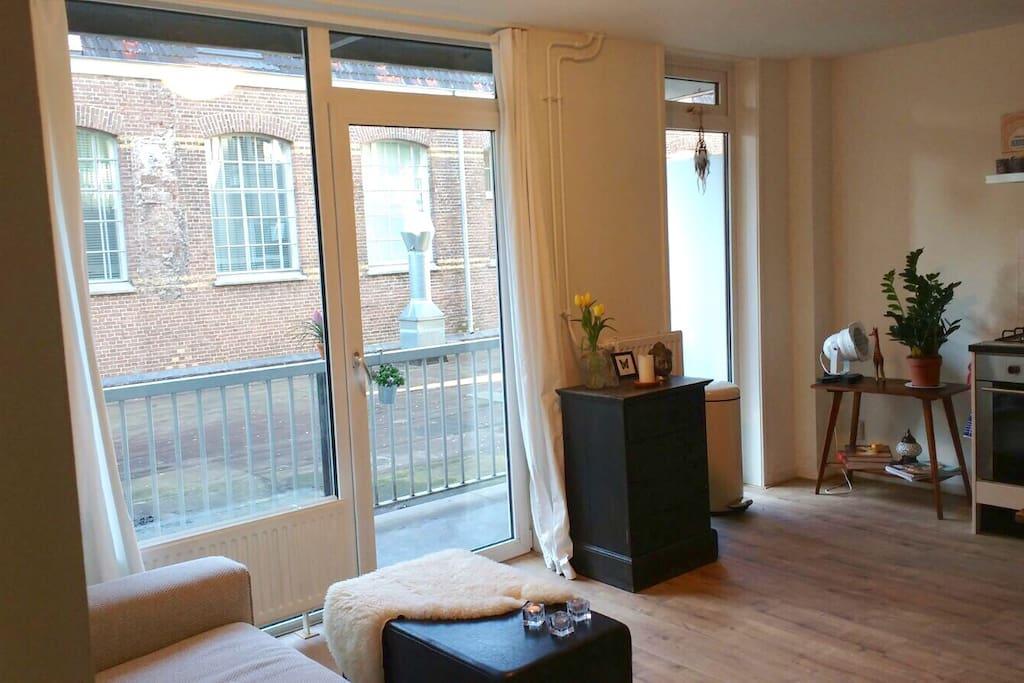 Light living room with balcony