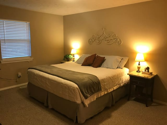 Plush King size bed with hypoallergenic pillow and mattress covers.
