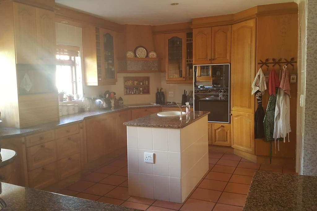 Large kitchen with separate scullery containing fridge, dishwasher, washing machine and dryer