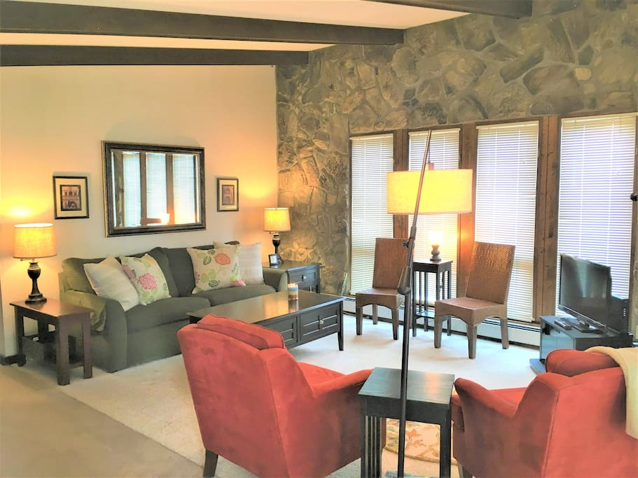 Lots of comfy seating in this third floor living room with vaulted ceilings