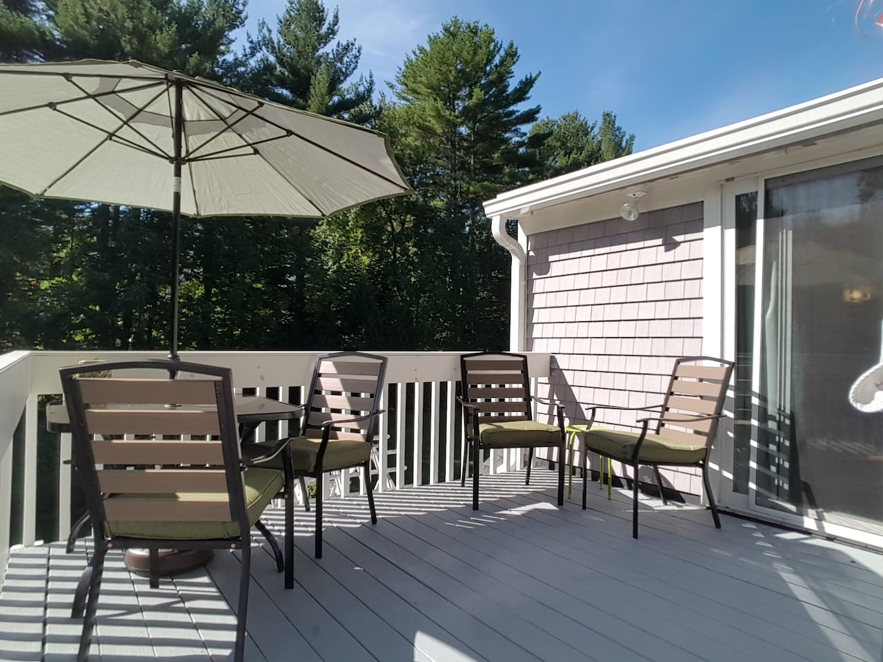 Relaxing deck perched above yard