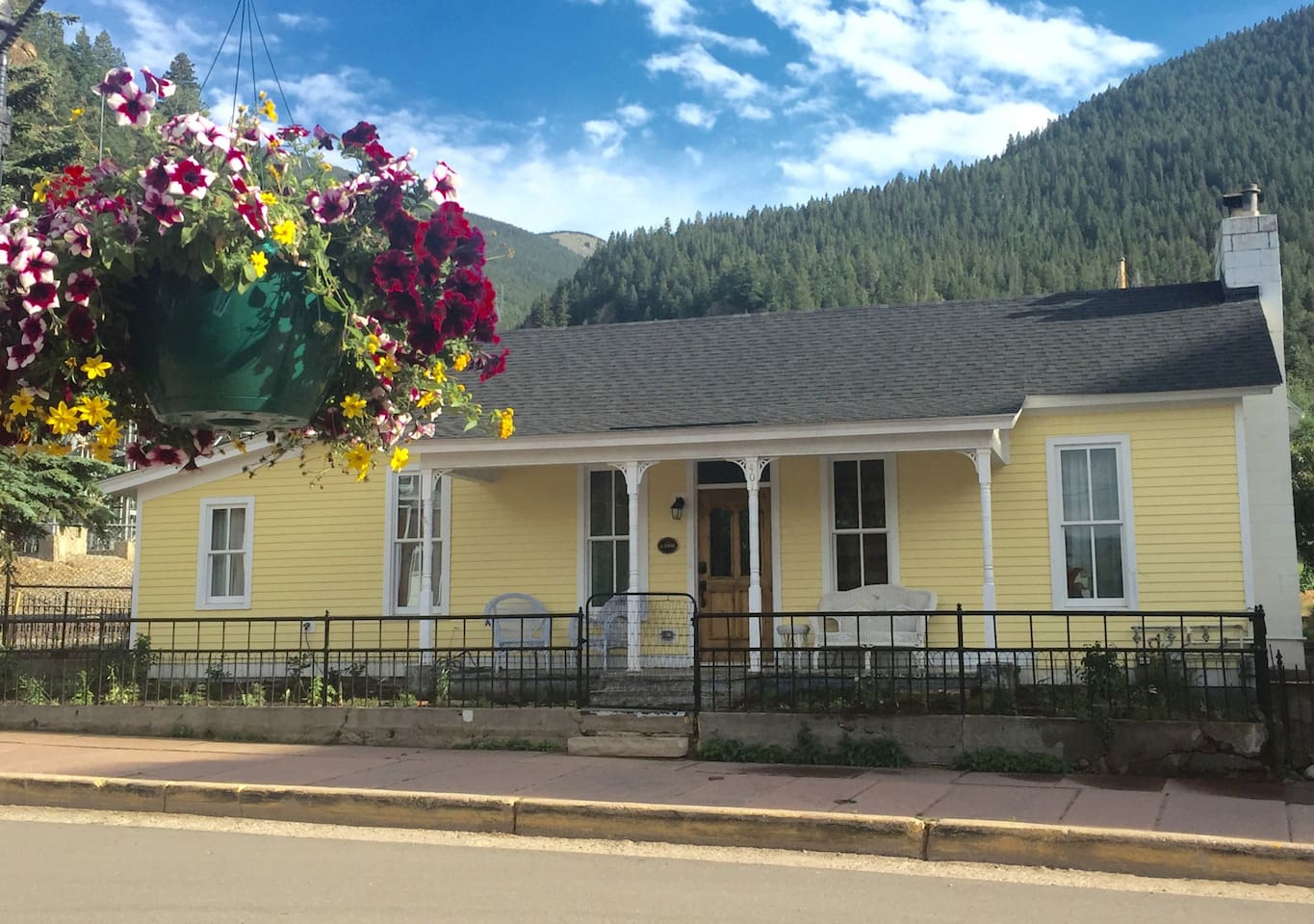 Remodeled 1865 home in Georgetown Colorado. Located in downtown at the end of the main street, 6th Street.  Four bedrooms, two full bathrooms (showers), seven beds. Comfortable for 4-10 persons. House looks small from the front but extends out to the back.
