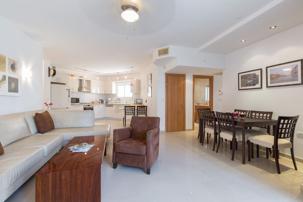 Open plan living and dining area with well equipped kosher kitchen
