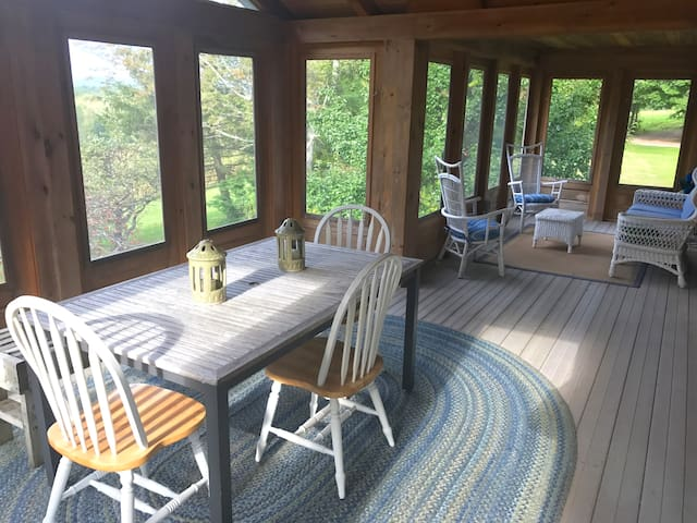 Dine on the screened-in porch