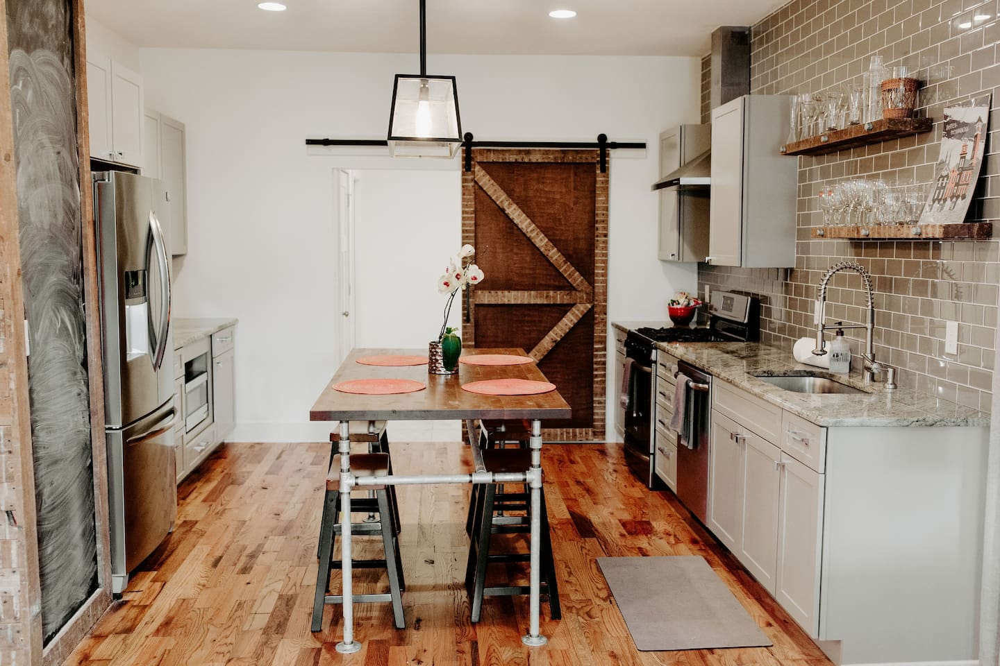 Modern and industrial kitchen with new stainless steel appliances and everything you need to cook a full meal