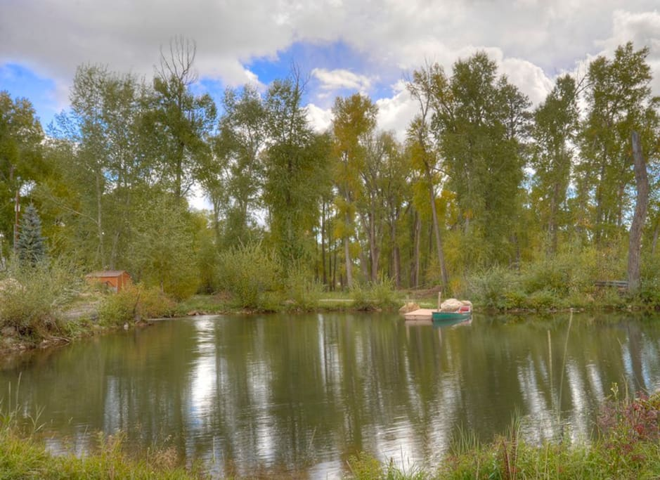 Canoe pond next to home at Durango Colorado waterfront vacation rental cabin river pond fly fishing canoe