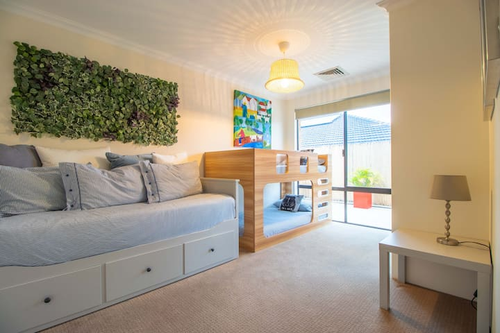 Great family room with daybed that converts to a full double bed as well as single-bed size bunk beds (bedroom 2).