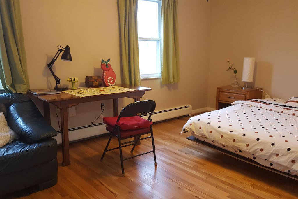 Your spacious room complete with desk, side table, couch, closet and private bath inside