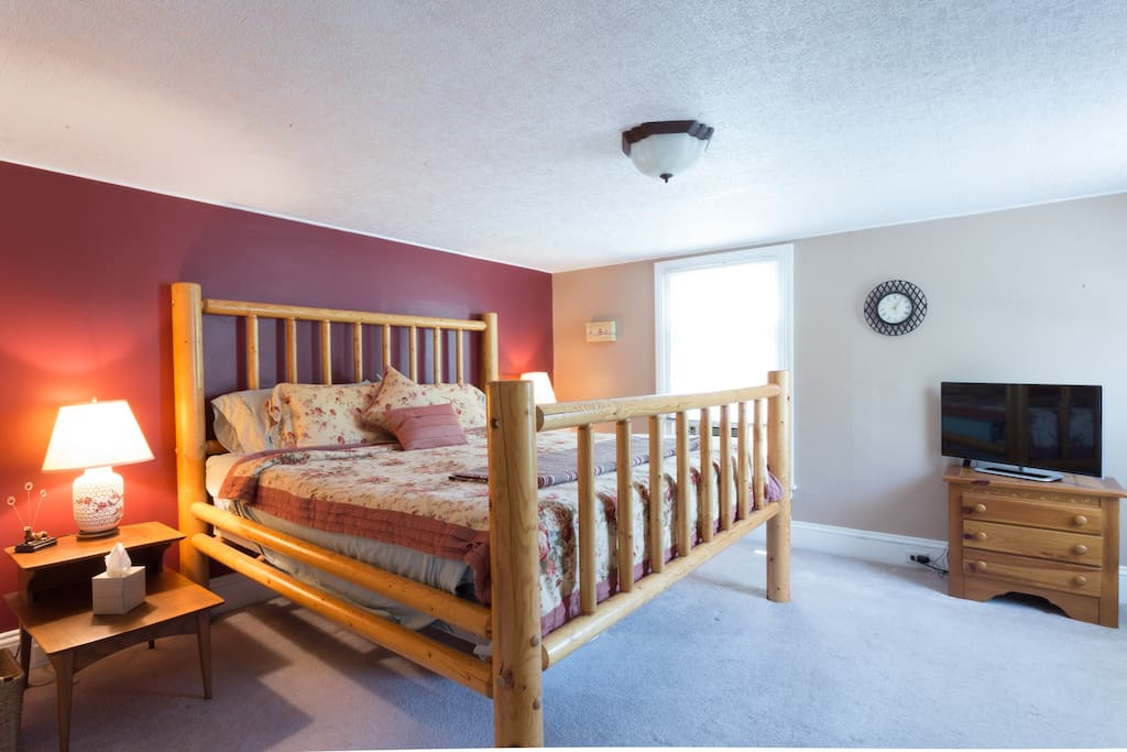 Master bedroom upstairs with king size bed
