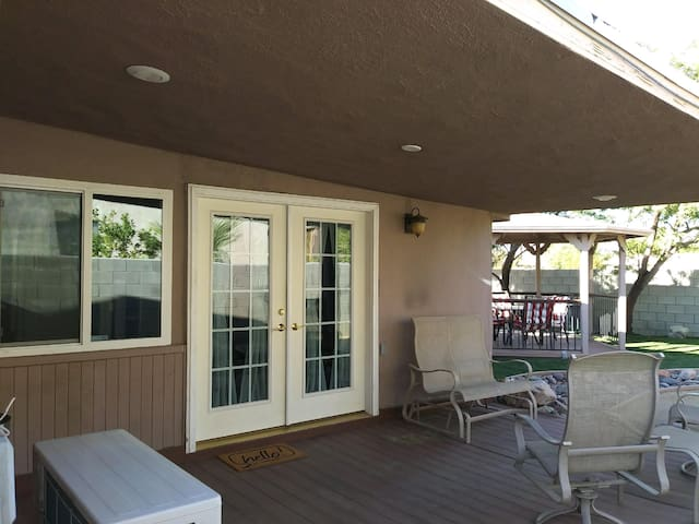 Back patio with entrance to your room.