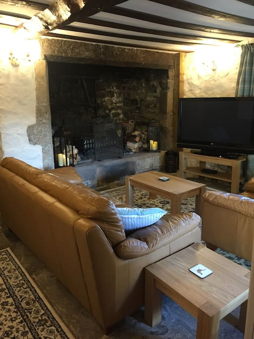 Sitting room with large inglenook fireplace