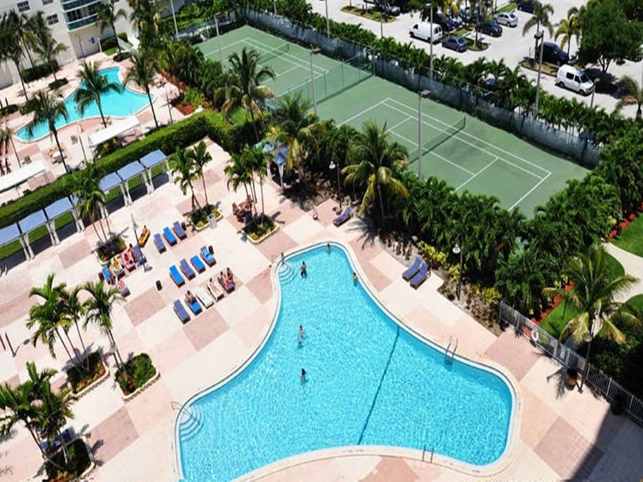 View of the magnificent tennis courts and the condo's outdoor heated pools