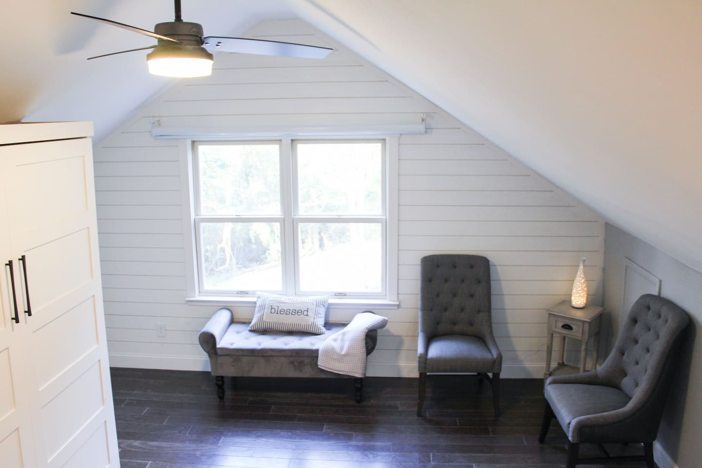 """Our """"WDP Loft"""" offers a lot of natural light in space with a calming grey paint color."""