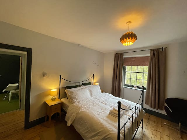 The River Bedroom has a kingsize iron bed, seating, and plenty of storage for clothes and cases.