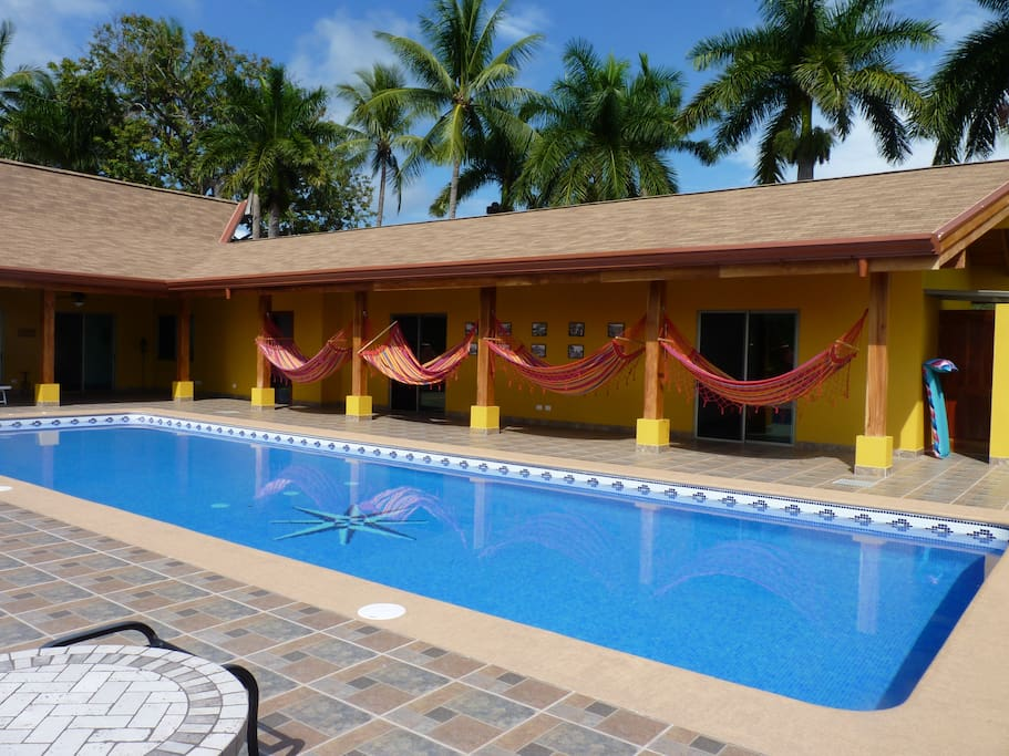 Pool  with hammocks and  pool side entrances to guest rooms