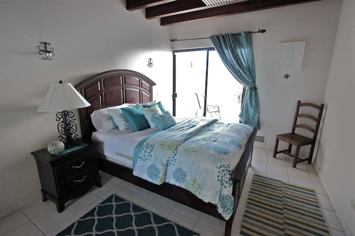 Our guest bedroom has it's own private deck that overlooks the ocean. Comfy beds w/1500+ count sheets.
