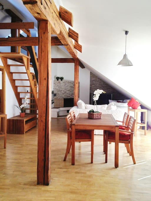 Modern & cosy attic apartment with beams. Very spacious living area. The whole apartment has 120m2.