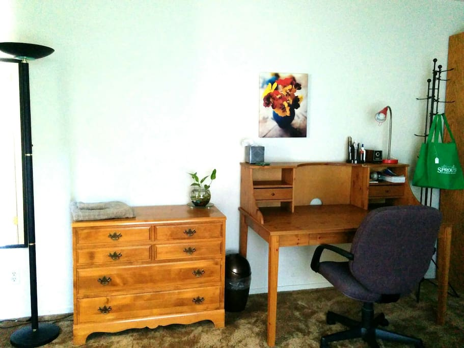Large work desk with office chair, refrigerator, hot water pot