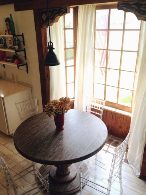Dining area in front of bay window with a lot of natural sunlight