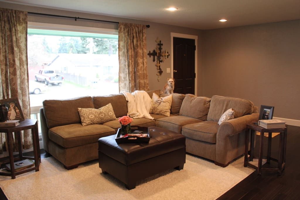 Living room with sectional couch and 50 inch TV
