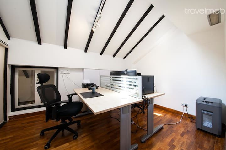 """View of SOHO """"office"""" for 2 from door way these are 6'x3' tables. If smaller 4'x3' tables, can comfortably fit 4 tables or conference table for 8."""